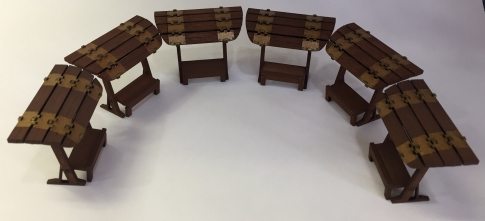 Six smaller one-sided stands are ready for goods.
