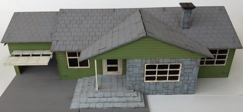 Outside colors are blocked in and ready for some weathering! The inside is still plain so far, but I'd love to fully decorate and furnish it eventually.